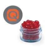 Twist top container with silver cap filled with cinnamon red hots