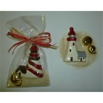 White Chocolate Lighthouse in the Sand with Foiled Sea Shells